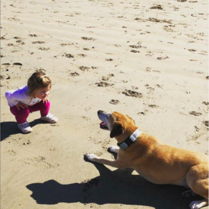 Mila Markowitz with her sister on the beach.